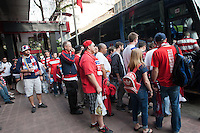 USA fans gather at the Galeria Plaza hotel to board a bus to take them to the USA vs. Mexico World Cup Qualifier at Azteca stadium in Mexico City, Mexico on March 26, 2013.