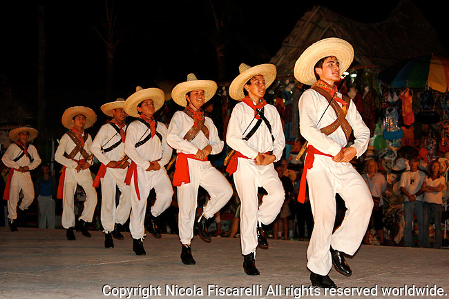 An evening  performance of Mexican folk dancing was organize by the Dancing school of Puerto Vallarta Mexico .