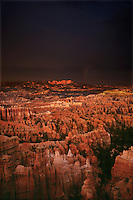730750069 a clearing summer monsoon storm leaves dark ominous clouds and a faint rainbow over the hoodoos and the pausagaunt plateau in bryce canyon national park in central utah
