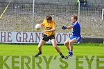 St Mary's Kieran O'Driscoll tries to stop Listowel Emmets David Sheehy in the intermediate championship semi-final at Austin stack park, Tralee on Sunday.