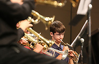 NWA Democrat-Gazette/DAVID GOTTSCHALK  Colton Usrey, 14, of Springdale, plays with the Hogwild Band Friday, July 14, 2017, during the 60th Junior High Band Camp Final Concerts at the Fayetteville High School Performing Arts Center. More than 1,000 student musicians will participate in the 60th annual University of Arkansas Summer Music Camp over the two week period from July 9 - 21.  Summer Music Camp is an annual program of the Department of Music's Community Music School.