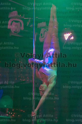 Timea Hegyi performs during the Miss Poledance Hungary 2011 competition in Budapest, Hungary on September 03, 2011. ATTILA VOLGYI
