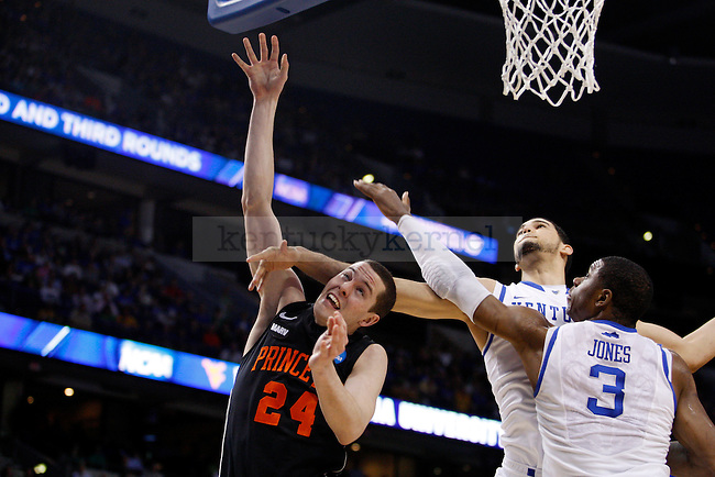 Eloy Vargas fouls Will Barrett in the first half UK's first round NCAA tournament game against Princeton at the St. Pete Times Forum in Tampa, Florida on Thursday, March 17, 2011.  Photo by Britney McIntosh | Staff