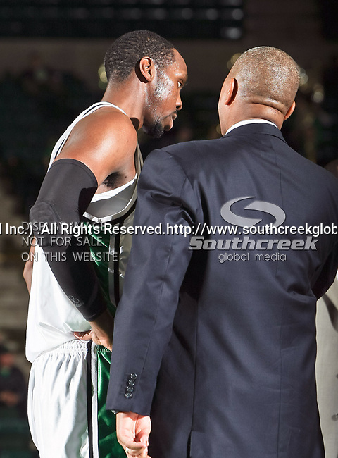 North Texas Mean Green forward George Odufuwa (4) discusses a play with Mean green head Coach Johnny Jones in the NCAA  basketball game between the Florida International University Panthers and the University of North Texas Mean Green at the North Texas Coliseum,the Super Pit, in Denton, Texas. UNT defeated FIU 87 to 77