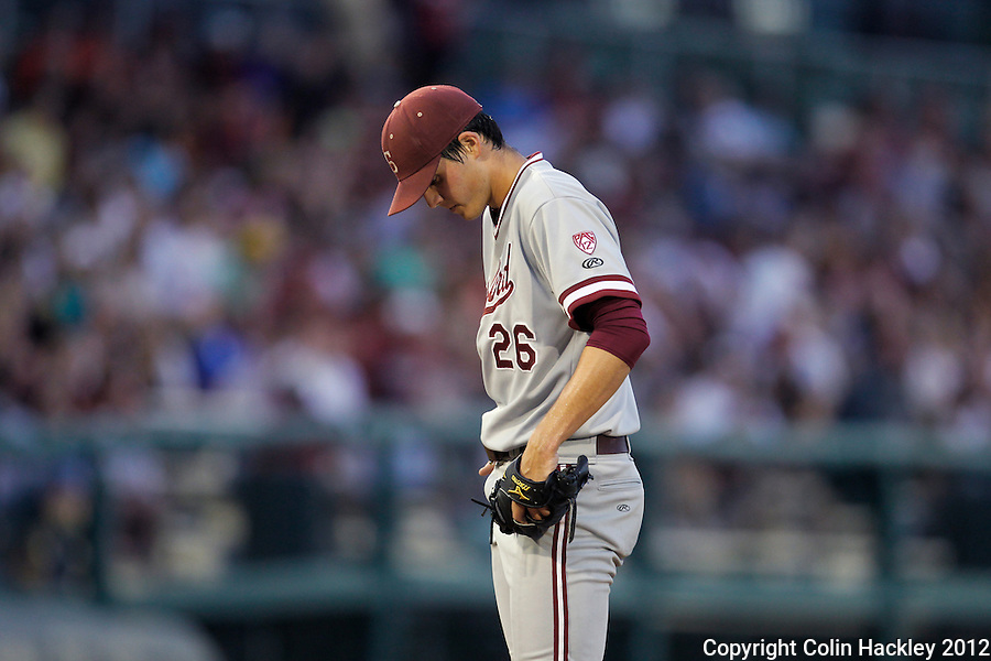 TALLAHASSEE, FL 6/8/12-FSU-STANFORD060812 CH-Stanford pitcher Mark Appel composes himself between throws against Florida State during fourth inning action of the NCAA Super Regional action Friday at Dick Howser Stadium in Tallahassee. Appel gave up seven runs int he inning. The Seminoles beat the Cardinal 17-1..COLIN HACKLEY PHOTO