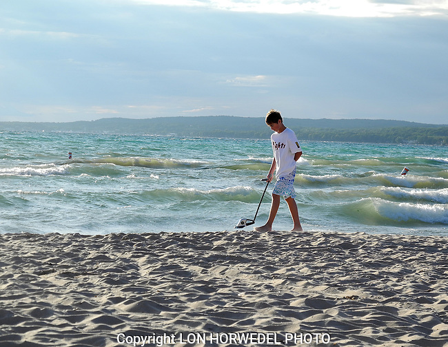 Pictures of the year 2012: My son Eamon searches for treasure along the shores of Lake Michigan in late Augist.