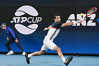 8th January 2020; Sydney Olympic Park Tennis Centre, Sydney, New South Wales, Australia; ATP Cup Australia, Sydney, Day 6; Croatia versus Argentina; Marin Cilic of Croatia versus Guido Pella of Argentina; Marin Cilic of Croatia stretches for a backhand return against Guido Pella of Argentina - Editorial Use