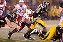 08 October 2009: Nebraska defensive tackle Ndamukong Suh makes the stop against Missouriat at Memorial Stadium, Columbia, Missouri. Nebraska defeated Missouri 27 to 12.