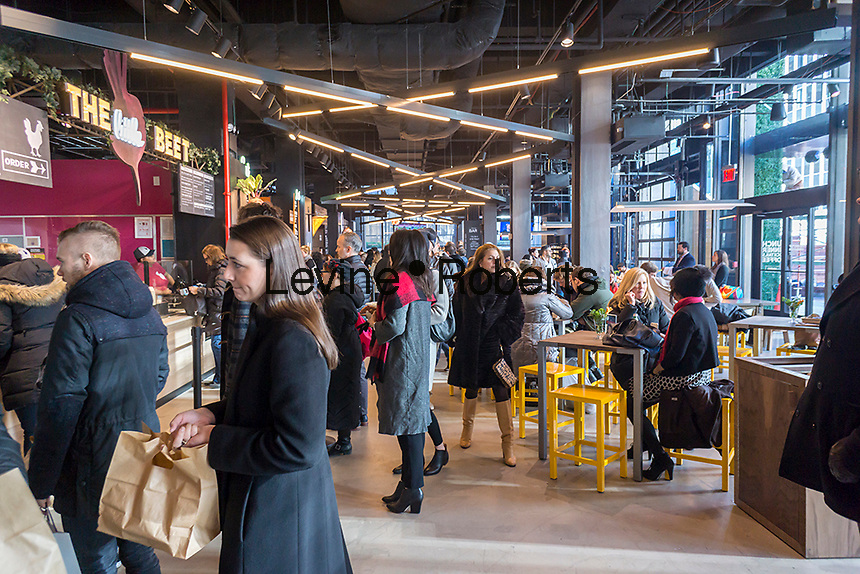 Foodies flock to The Pennsy food hall, located above Pennsylvania Station in New York on its grand opening day, Monday, January 11, 2016. Located in the former Borders Bookstore space, the 8000 square foot space brings several popular eateries together and adds a welcome addition of fast casual fare to the Penn Station area where the food choices are severely lacking. (© Richard B. Levine)