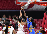 College Park, MD - March 25, 2019: Maryland Terrapins forward Stephanie Jones (24) avoids having her shot  blocked by Kennedy Burke (22) with the help of the net during second round game of NCAAW Tournament between UCLA and Maryland at Xfinity Center in College Park, MD. UCLA advanced to the Sweet 16 defeating Maryland 85-80.(Photo by Phil Peters/Media Images International)