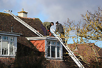 BNPS.co.uk (01202 558833)<br /> Pic: CorinMesser/BNPS<br /> <br /> Roof repairs.<br /> <br /> Homeowners are counting the cost today after a 'tornado' hit a south coast town overnight.<br /> <br /> Residents in Barton-on-Sea, Hants, were woken at 4am as the twister blasted its way through the town like an 'express train'. <br /> <br /> The strength of the winds of up to 80mph shook numerous houses, sending roof tiles smashing to the ground.<br />  <br /> A 30ft long brick wall collapsed under the strength of the gusts while fence panels were flung through the air.<br /> <br /> Part of a garden shed that had been picked up by the tornado smashed a hole through the windscreen of a car.