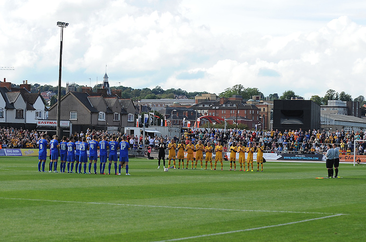 Newport County and Mansfield Town players observe a minutes applause for four Newport County fans who passed away <br /> <br /> (Photo by Ian Cook/CameraSport)<br /> <br /> Football - The Football League Sky Bet League Two - Newport County v Mansfield Town - Saturday 7th September 2013 - Rodney Parade - Newport<br /> <br /> &copy; CameraSport - 43 Linden Ave. Countesthorpe. Leicester. England. LE8 5PG - Tel: +44 (0) 116 277 4147 - admin@camerasport.com - www.camerasport.com