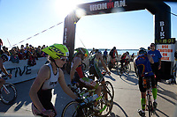 Athletes head down the Monona Terrace ramp to begin the biking leg of the 2015 Ironman competition on Sunday, September 13, 2015 in Madison, Wisconsin