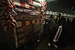 A souvenir selling talking to fans as he sells his scarves outside the Britannia Stadium, Stoke-on-Trent, before the UEFA Europa League last 32 first leg between Stoke City and visitors Valencia. The match ended in a 1-0 victory from the visitors from Spain. Mehmet Topal scored the only goal in the first half in a match watched by a crowd of 24,185.