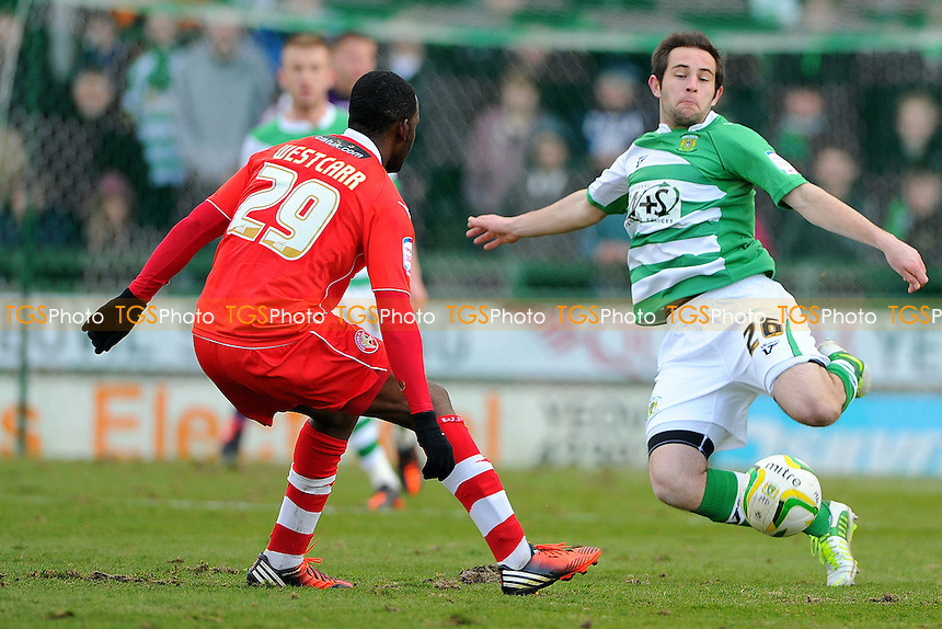 Matthew Dolan of Yeovil Town clears from Craig Westcarr of Walsall - Yeovil Town vs Walsall - NPower League One Football at Huish Park, Yeovil, Somerset - 29/03/13 - MANDATORY CREDIT: Denis Murphy/TGSPHOTO - Self billing applies where appropriate - 0845 094 6026 - contact@tgsphoto.co.uk - NO UNPAID USE.