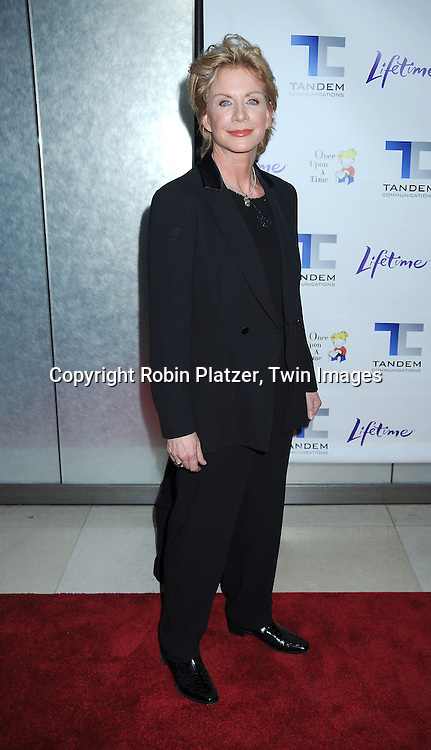 "author Patricia Cornwell  posing for photographers at The Lifetime Television screening of Patricia Cornwell's novel ""The Front"" starring Daniel Sunjata, Andie MacDowell and Ashley Williams at The Hearst Tower on April 7, 2010."