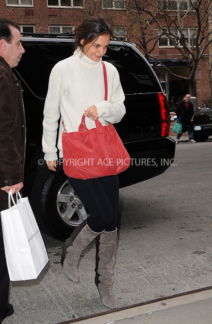 WWW.ACEPIXS.COM . . . . .  ....December 17 2011, New York City....Katie Holmes out in her East Village neighborhood on December 17 2011 in New York City....Please byline: CURTIS MEANS - ACE PICTURES.... *** ***..Ace Pictures, Inc:  ..Philip Vaughan (212) 243-8787 or (646) 679 0430..e-mail: info@acepixs.com..web: http://www.acepixs.com