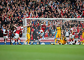 1st October 2017, Emirates Stadium, London, England; EPL Premier League Football, Arsenal versus Brighton; Nacho Monreal of Arsenal scores his sides first goal and jumps in celebration, 1-0 Arsenal