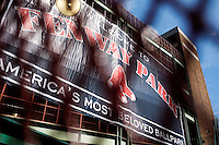 """A banner reading """"Fenway Park, America's Most Beloved Ballpark"""" hangs inside a gate at Fenway Park in Boston, Massachusetts, USA."""