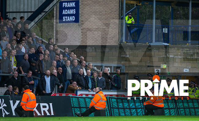 Police & Stewards keep watch on away support during the Sky Bet League 2 match between Wycombe Wanderers and Oxford United at Adams Park, High Wycombe, England on 19 December 2015. Photo by Andy Rowland.