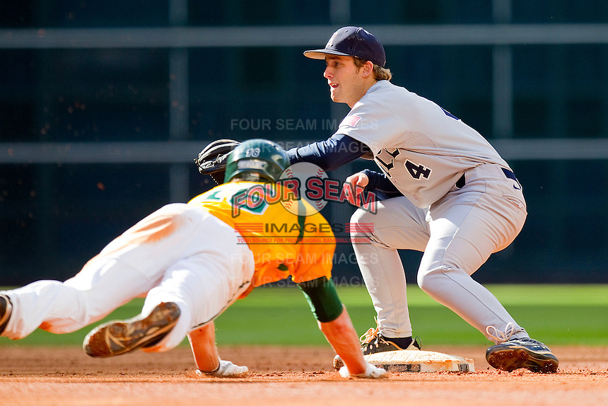 Shortstop Derek Hamilton #4 of the Rice Owls waits for the throw as Brooks Pinckard #16 of the Baylor Bears slides head first into second base at Minute Maid Park on March 6, 2011 in Houston, Texas.  Photo by Brian Westerholt / Four Seam Images