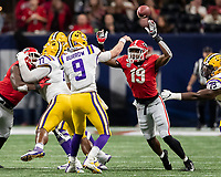 ATLANTA, GA - DECEMBER 7: Adam Anderson #19 of the Georgia Bulldogs attempts to pressure Joe Burrow #9 of the LSU Tigers during a game between Georgia Bulldogs and LSU Tigers at Mercedes Benz Stadium on December 7, 2019 in Atlanta, Georgia.
