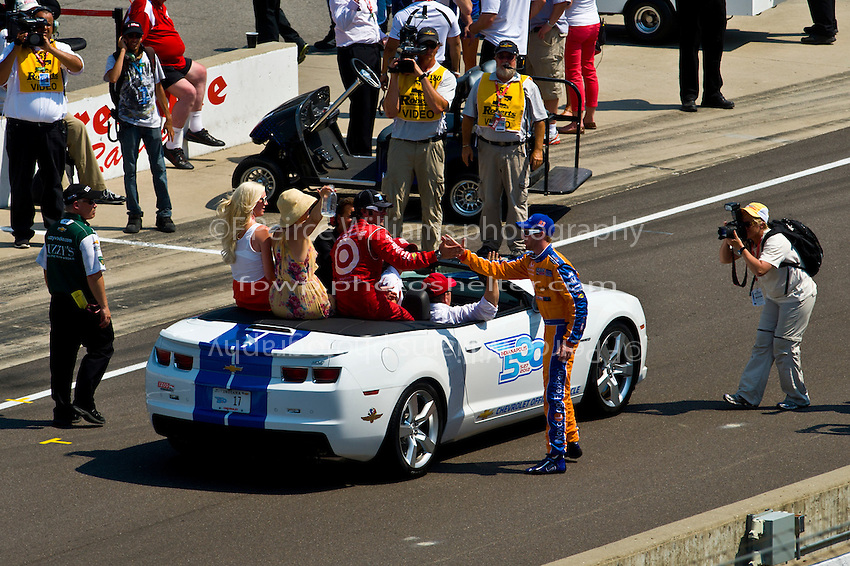 "On his ""Victory Lap"", winner Dario Franchitti (#50) is congratulated by Ganassi teammate Charlie Kimball (#83)."