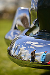 Floral Park, New York, U.S. - April 27, 2014 - A green 1953 Dodge Coronet Diplomat front chrome upright and bumper reflect visitors and beautiful blue sky  at the 35th Annual Antique Auto Show at Queens Farm.
