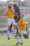 Torrance, CA 02/23/11 - Steven Ingraham (West #3) and Bryan Breslin (Tesoro #11) jump for the header as West's Andrew Johnson  (West #7) looks on.