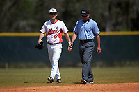 Illinois State Redbirds center fielder Sean Beesley (29) is escorted off the field by umpire Zach Tiche after being ejected during a game against the Michigan State Spartans on March 8, 2016 at North Charlotte Regional Park in Port Charlotte, Florida.  Michigan State defeated Illinois State 15-0.  (Mike Janes/Four Seam Images)