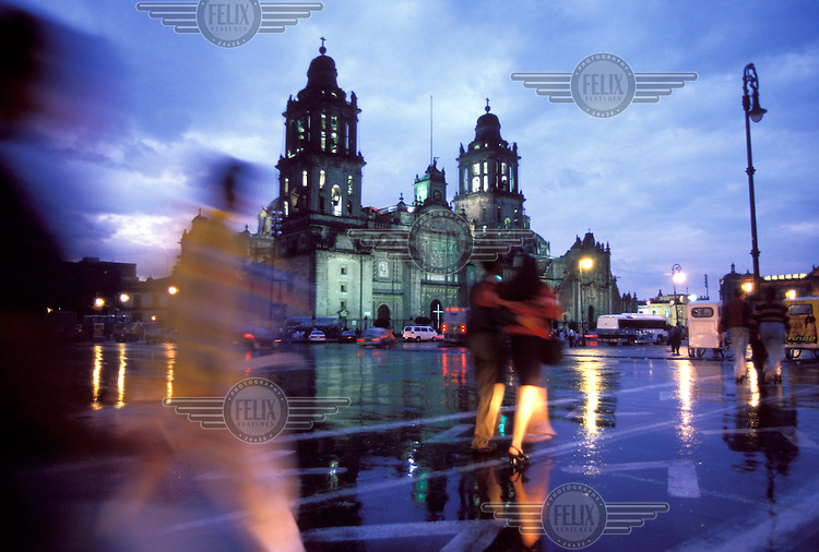 © Mark Henley / Panos Pictures..Mexico City, MEXICO...The cathedral in the Zocalo, the city's main square, lit up on a rainy evening.