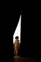 June 6th, 2008_Phnom Penh, Cambodia_ A dance troop member from the National School of Fine Arts, can be seen backstage, during a performance of the newly revived work of Preah Anruch Preah Neang Ossa.  It has been some 50 years, since this classical Khmer dance piece was performed publicly and is being produced by the Amrita Performing Arts Association.   Photographer: Daniel J. Groshong/Tayo Photo Group