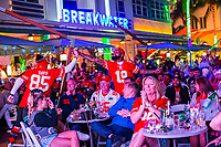 MIAMI, FL - FEBRUARY 2: Fans celebrate during the Super Bowl XLIV at the beach on February 2, 2020 in Miami, USA. (Photo by Kena Betancur/VIEWpress/Getty Images)