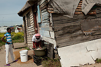 Township life is challenging. Running water is a luxury, and typically one tap will service as many as 50 families. Buckets are essential tools in the daily challenge of fetching water for all household needs.