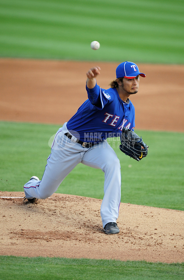 Mar. 7, 2012; Peoria, AZ, USA; Texas Rangers pitcher Yu Darvish pitches in the first inning against the San Diego Padres at Peoria Stadium.  Mandatory Credit: Mark J. Rebilas-.