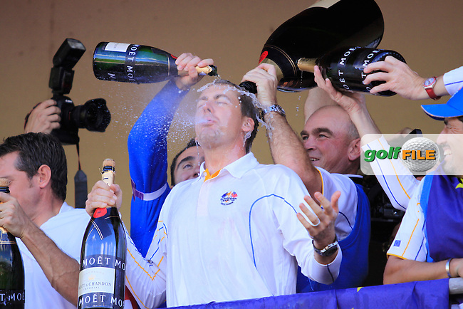 Thomas Bjorn drenches Ian Poulter in champagne as Europe Celebrate after winning the Ryder Cup in Mondays Singles at the 2010 Ryder Cup at the Celtic Manor, Newport, Wales, 4th October 2010..Picture Manus O'Reilly/www.golffile.ie