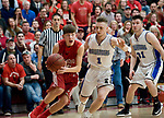 WOLCOTT, CT-031418JS11- Wamogo's Eric Odenwaelder (25) drives to the basket past East Hampton's Nic DiStefano (1) during their Division V semifinal game Wednesday at Wolcott High School. <br /> Jim Shannon Republican-American