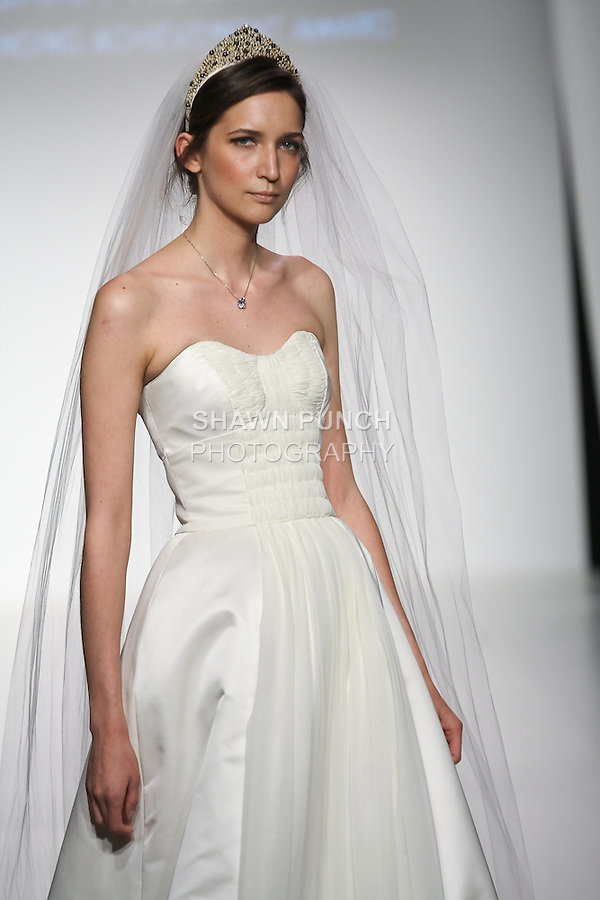 Model walks runway in a bridal dress from the Look Me in the Heart collection by Dara N. Rosen, during the Pratt 2011 fashion show. This collection won the Outstanding Achievement Award.