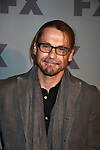 Kurt Sutter stars in FX's Sons of Anarchy as they pose on the red carpet at FX 2012 Ad Sales Upfront held on March 29, 2012 at Lucky Stirke, New York, New York. (Photo by Sue Coflin/Max Photos)