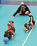 November 18 2011 - Guadalajara, Mexico:   Bruno Hache and Ahmad Zeividavi of Canada dive to block the ball during the Goalball Bronze Medal Match in the San Rafael Park Sports Complex at the 2011 Parapan American Games in Guadalajara, Mexico.  Photos: Matthew Murnaghan/Canadian Paralympic Committee