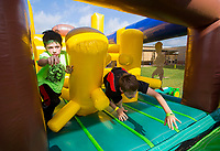 NWA Democrat-Gazette/JASON IVESTER<br /> Riley Sharp (left) and Landon Easter, both fifth-graders, race through an inflatable Thursday, May 18, 2017, during the Fun and Field Day at Old High Middle School in Bentonville. Next Friday is the last day of school for Bentonville students.