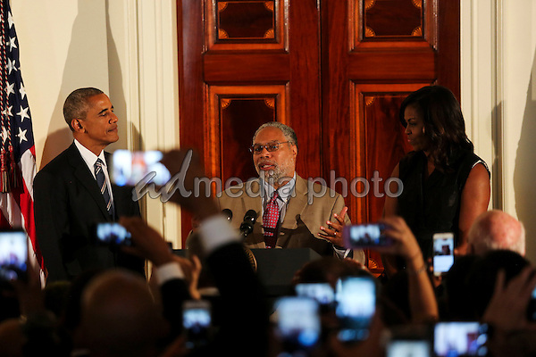 US President Barack Obama listens to Lonnie Bunch, the director of the Smithsonian National Museum of African American History and Culture,  delivering remarks at the reception in honor of the opening of the museum in the Grand Foyer of the White House September 22, 2016, Washington, DC. Photo Credit: Aude Guerrucci/CNP/AdMedia