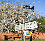 Village sign and road distances to nearby villages, Hollesley, Suffolk, England