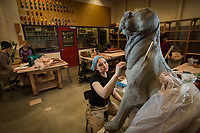 Lauren Stanford works on a clay sculpture during  Intermediate Handbuilt Ceramics (ART A301) in UAA's fine arts building.