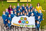 Loughfouder NS pupils celebrate with their Principal Elizabeth Lane and teacher Emer O'Shea receiving their Digital Schools of Distinction flag at the school on Friday