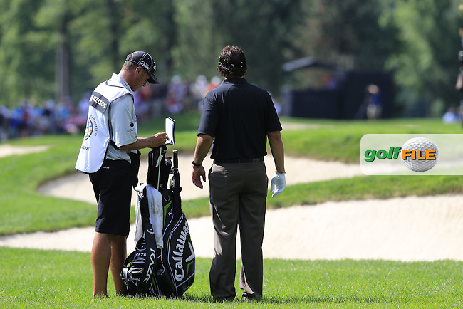 Phil Mickelson (USA) and caddy Jim &quot;Bones&quot; Mackay on the 14th hole during Friday's Round 1 of the 2013 Bridgestone Invitational WGC tournament held at the Firestone Country Club, Akron, Ohio. 2nd August 2013.<br /> Picture: Eoin Clarke www.golffile.ie