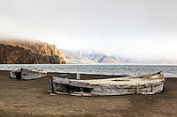 The remains of 2 decaying water boats on the beach of Whalers Bay, Deception Island stands testament to the whaling history in the Antarctic region.  Water boats were used to bring freshwater from the land to the whaling ships anchored in the bay. Deception Island is part of the South Shetland Islands near the Antarctic Peninsula..
