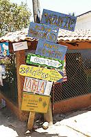 hand made sign posts in Mazunte, Oaxaca.