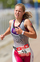 28 JUL 2013 - LONDON, GBR - Jenny Manners makes her way to the turn by Building 1000 during the run for the elite women's race at the 2013 Virgin Active London Triathlon in Excel, Royal Victoria Dock, London, Great Britain (PHOTO COPYRIGHT © 2013 NIGEL FARROW, ALL RIGHTS RESERVED)