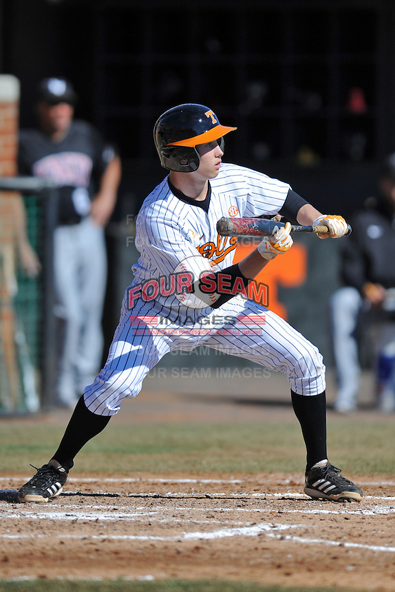 Tennessee Volunteers shortstop A.J. Simcox #10 squares  to bunt during a game against the UNLV Runnin' Rebels at Lindsey Nelson Stadium on February 22, 2014 in Knoxville, Tennessee. The Volunteers defeated the Rebels 5-4. (Tony Farlow/Four Seam Images)